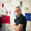Portrait of happy man working as fashion designer - Stock Photo