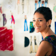 Portrait of happy hispanic young woman working as fashion design - Stock Photo