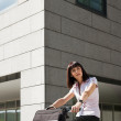 Woman riding bicycle and going to work — Stock Photo #13886885