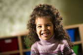 Happy child smiling for joy at camera in kindergarten — Stock Photo