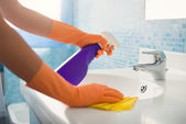 Woman doing chores cleaning bathroom at home — Stok fotoğraf
