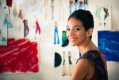 Portrait of happy hispanic young woman working as fashion design — 图库照片