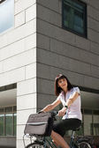 Woman riding bicycle and going to work — Foto Stock