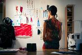 Female fashion designer contemplating drawings in studio — Stock Photo