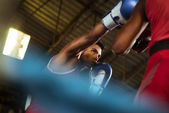 Two male athletes fight in boxing ring — Stock Photo