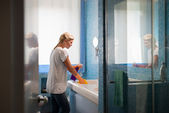 Young woman doing chores and cleaning bathroom at home — Stock Photo