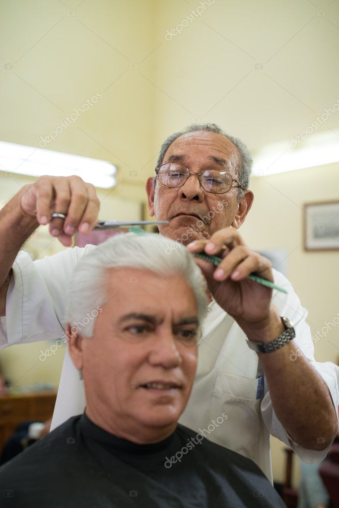 Active retired old , man getting an haircut by senior barber in old fashion barber\'s shop. Copy space — Stock Photo #13885818