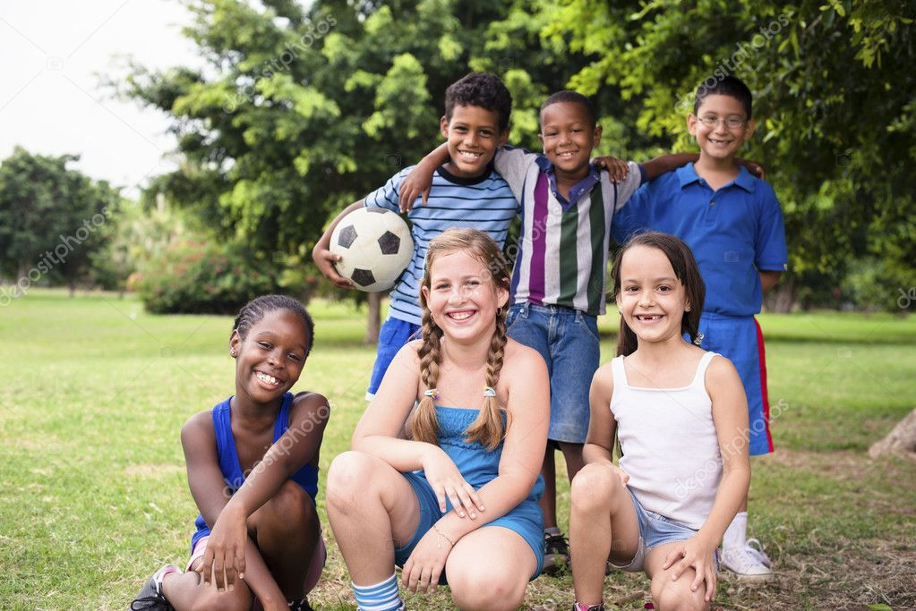Young boys and sport, portrait of three young children with football looking at camera. Summer camp fun — Stock Photo #13886503
