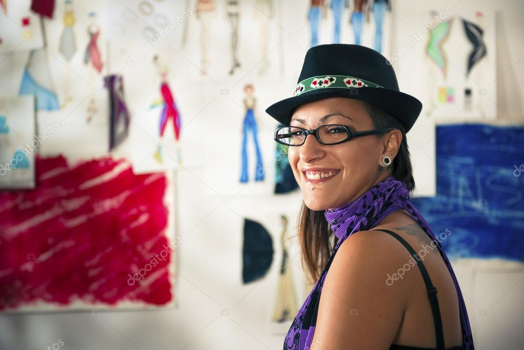 Confident entrepreneur, portrait of happy hispanic young woman working as fashion designer and dressmaker in atelier — Stock Photo #13886655