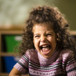 Happy female child smiling for joy in kindergarten — Stok fotoğraf