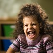Happy female child smiling for joy in kindergarten — Stock Photo