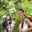 With backpack doing trekking in wood — Stock Photo #21232913