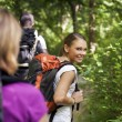 With backpack doing trekking in wood - Stock Photo