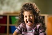 Happy female child smiling for joy in kindergarten — Stock Photo