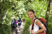 With backpack doing trekking in wood — Stock Photo