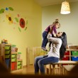 And fun, teacher playing with little girl at school — ストック写真