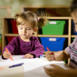 Постер, плакат: Children and fun two preschoolers drawing in kindergarten