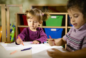 Children and fun, two preschoolers drawing in kindergarten — Stock Photo
