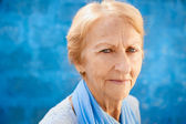 Happy old blond woman smiling and looking at camera — Stock Photo