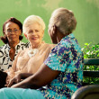Group of elderly black and caucasian women talking in park — Stock Photo