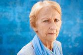 Sad old blond woman looking at camera — Stock Photo