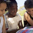 Stock Photo: Children and education, kids and girls reading book in park
