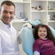 Portrait of child and dentist in dental studio, looking at camer — Stock Photo