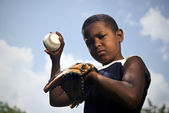 Sport, baseball and kids, portrait of child throwing ball — Stock Photo