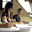 Happy student studying and writing, portrait of hispanic young m — Foto de Stock