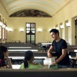 Group of happy students and friends studying in school library — Stok fotoğraf