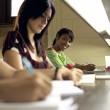 Portrait of happy female student writing, african american woman — Stock Photo