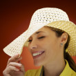 Pretty woman with straw hat smiling and having fun — Stock Photo