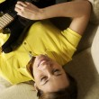 Woman playing and training with electric guitar at home — Stock Photo