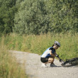 Young womtraining on mountain bike and cycling in park — Stock Photo #27694121