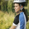 Young woman training on mountain bike and cycling in park — Stock Photo