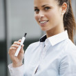 Portrait of young woman smoking electronic cigarette — Stock Photo #29096273