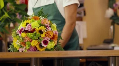 Happy man working as florist in flower shop — Stock Video #32317203