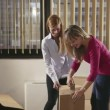 Team of business women moving office packing boxes — Stock Video