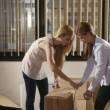 Team of business women moving office packing boxes — Стоковое видео