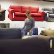 Woman shopping for furniture and home decor — Stock Photo