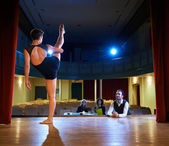 Woman dancing for audition with jury in theater — Stock Photo