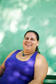 Portrait of fat woman looking at camera and smiling — Stock Photo