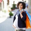 Portrait of happy and smiling pregnant woman shopping — Stock Photo #48423119