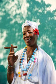 Portrait of cuban black woman smoking cigar — Stock Photo