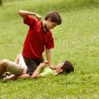 Violent kid fighting and hitting scared boy in park — Stock Photo #48786847