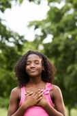 Portrait of black girl in love daydreaming and smiling — Стоковое фото