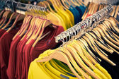 Clothing and retail store-view of shop with t-shirt — Stock Photo