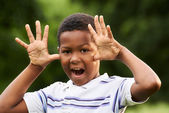 Happy african boy making a grimace at camera — Stock Photo