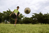 Kid playing football and soccer game in park — Stock Photo