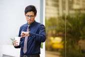 Portrait of chinese office worker checking time watch — Foto Stock